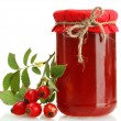 Stock Photo: Jar with hip roses jam and ripe berries, isolated on white