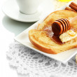 Stock Photo: White bread toast with honey and cup of coffee, isolated on white