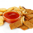 Crackers and sauce, isolated on white — Stock Photo