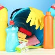Cleaning items in bucket on color background — Stock Photo #27785833