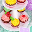 Delicious beautiful  cupcakes on festive table close-up — Стоковая фотография