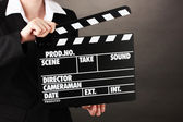 Movie production clapper board isolated on black — Photo