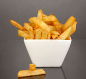 French fries in bowl isolated on black — Stock Photo