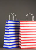Striped bags on gray background — Stock Photo