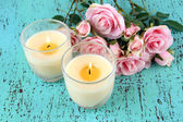 Candles on wooden table close-up — Stock Photo
