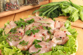 Chicken meat on wooden board,herbs and spices close-up — Stock Photo