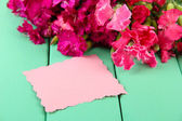 Bouquet of carnations, on color wooden background — Stock Photo