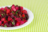 Beet salad in plate on table close-up — Stock Photo