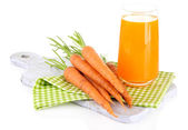 Glass of carrot juice and carrots, isolated on white — Stock Photo