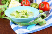 Cabbage soup in plates on napkin on wooden table — Stock Photo