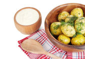 Boiled potatoes on wooden bowl on napkins isolated on white — Stock Photo