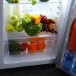 Open refrigerator with vegetarian food — ストック写真