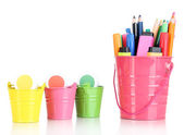 Gouache paint, pens and markers of various colors in baskets isolated on white — Stock Photo