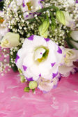Bouquet of eustoma flowers on color wooden background — Stock Photo
