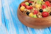 Oatmeal with fruits on table close-up — Stock fotografie