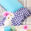 Home interior background with sofa, plaid, flowers and cup — Stock Photo