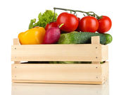 Fresh vegetables in wooden box on white background — Stock Photo