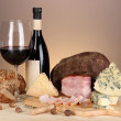 Exquisite still life of wine, cheese and meat products — Stock Photo #27842923