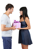 Beautiful loving couple with gift isolated on white — Stockfoto