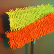 Stock Photo: Two mops for floor on bright background