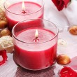 Beautiful red candles with flower petals in water — Stock Photo #27851593