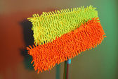 Two mops for floor on bright background — Stock Photo