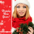 Attractive young woman holding Christmas wreath — Stock Photo