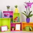 Beautiful colorful shelves with different home related objects — Stock Photo #27893955