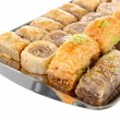 Sweet baklava on tray isolated on white — Stock Photo #27896015