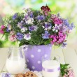 Beautiful bouquet in pail on wooden table on natural background — Stock Photo #27898657