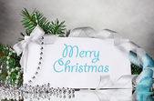 Christmas postcard and decor on gray background — Stock Photo