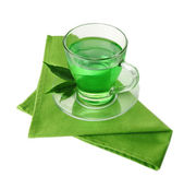 Transparent cup of green tea on napkin, isolated on white — Stock Photo