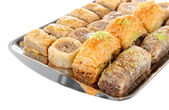 Sweet baklava on tray isolated on white — Stock Photo