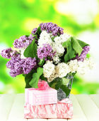 Beautiful lilac flowers, on wooden table on bright background — 图库照片