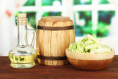 Green cabbage, oil, spices on cutting board, on bright background — Stock Photo