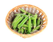 Green peas in basket isolated on white — Stock Photo