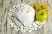 Refined sugar in white sugar bowl on wooden background — Stock Photo