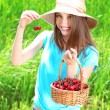 Portrait of beautiful young woman with berries in the field — Foto de Stock