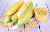 Fresh corn vegetable on wooden table — Stock Photo