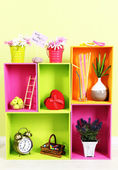 Shelves of different bright colors with decorative addition on wall background — Stock Photo