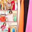 Collage of photos with young females shoppers — Stock Photo #27961419