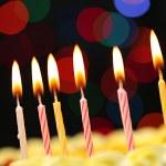Happy birthday cake, on black background — Stock Photo