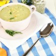 Nourishing soup in pink pon wooden table close-up — Stock Photo #27962033