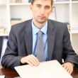 Young businessman with laptop computer shouting down on his workplace — Stock Photo