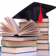 Stock Photo: Grad hat with books isolated on white