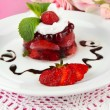 Tasty jelly dessert with fresh berries, on color wooden background — Lizenzfreies Foto