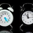 Two old style alarm clocks isolated on black — Stock Photo