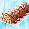 Sweet roll on plate on table close-up — Stock Photo #27965637