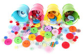 Colorful buttons strewn from buckets isolated on white — Stock Photo