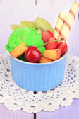 Delicious ice cream with fruits and berries in bowl on wooden table — Stock Photo